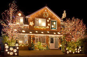 LED Christmas lights decorating an outdoor yard and house