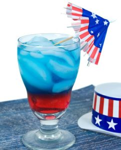 Red, white and blue drink with patriotic hat and umbrella.