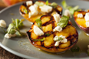 Gourmet Roasted Peaches with cheese, basil and Dressing