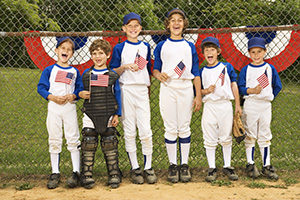 Summer Americana means young baseball team holding American flags