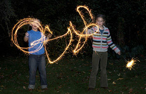 Summer Americana means kids playing with sparklers at night
