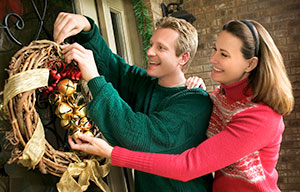 hanging a wreath on the front door
